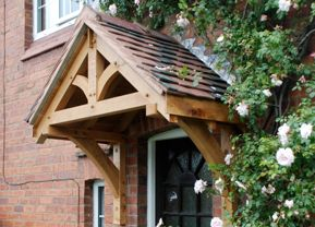 Stain same colour as fence. Paint foor gloss white / Oak canopy / oak door. http://mudputty.co.uk/isabelle-door-canopy-98-p.asp http://www.shropshiredoorcanopies.co.uk/whitemere.html