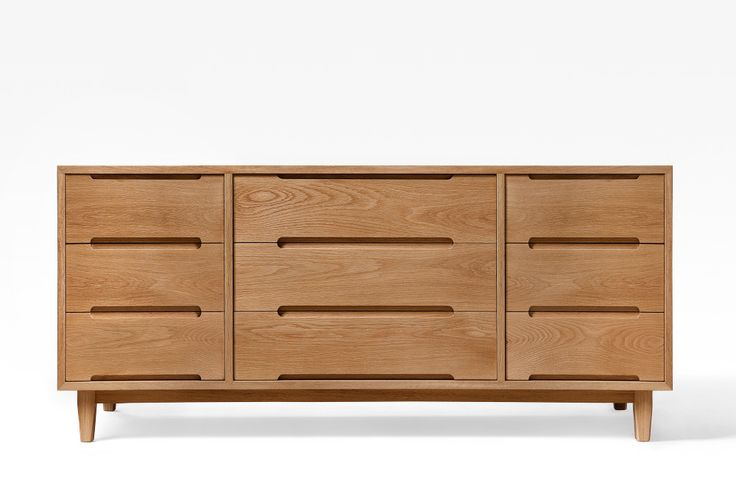 very clean lines in this Mid Century inspired chest of drawers. No veneers in this 100% solid timber piece (carcass and drawers) Modern 'touch to open' drawer runner mechanisms ensure the act of opening drawers is always a pleasure.
