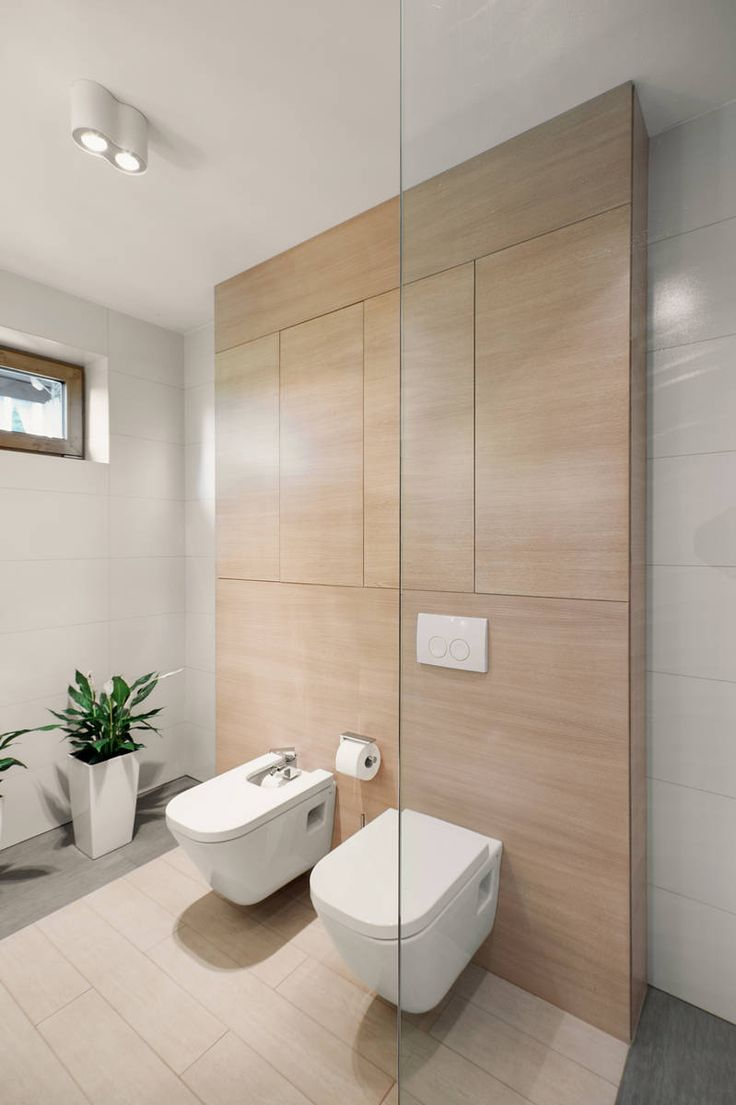 Bathroom with Wooden Wall and Glass Panel under White Ceiling