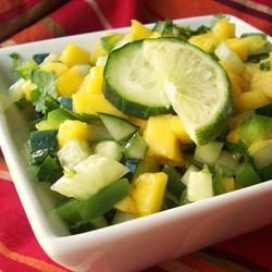 Cucumber-Mango Salsa Allrecipes.com - Served this with grilled smoked salmon and garlic bread. The whole family loves it. Will serve it often.
