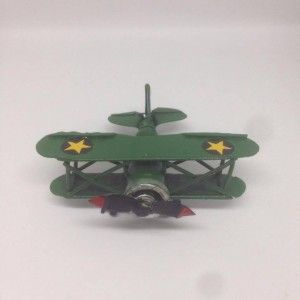 Vintage miniatur airplane green
