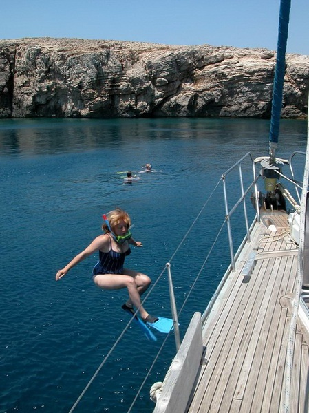 Sailing in Greece:   Linda takes the plunge in Macronisi, Dodecanese islands.