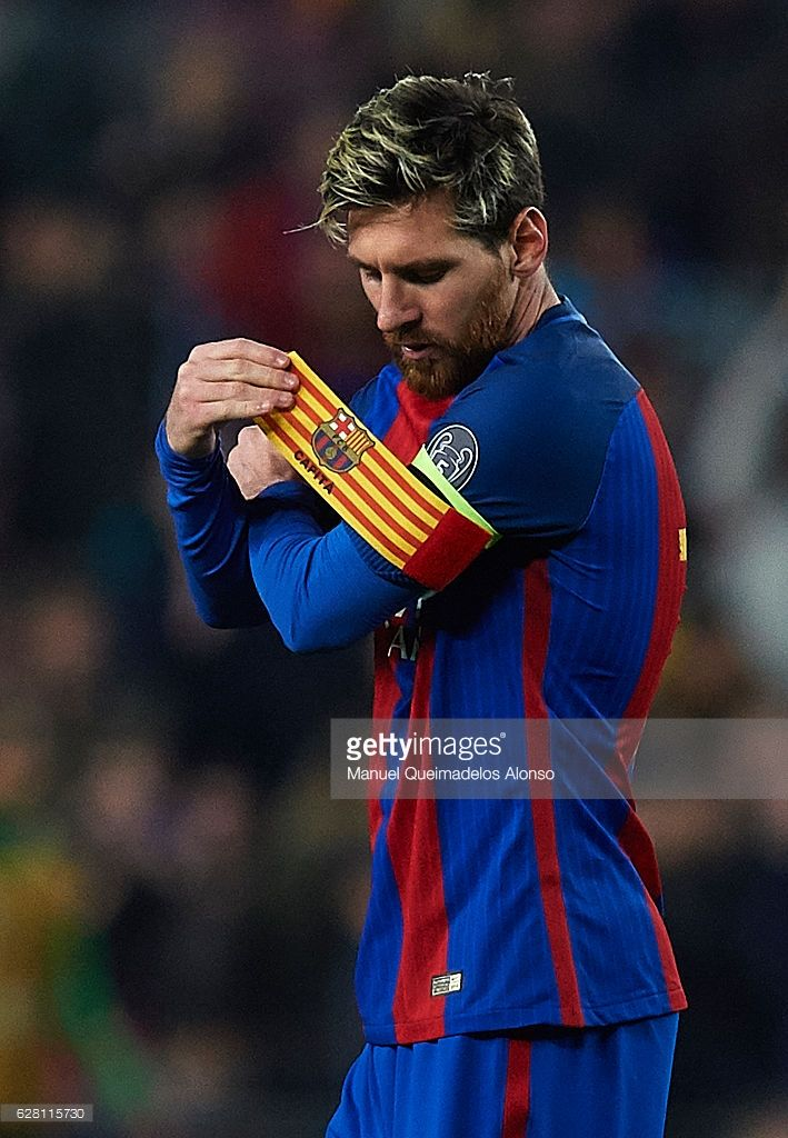 Lionel Messi of FC Barcelona adjusts the captains armband during the UEFA Champions League Group C match between FC Barcelona and VfL Borussia Moenchengladbach at Camp Nou on December 6, 2016 in Barcelona.