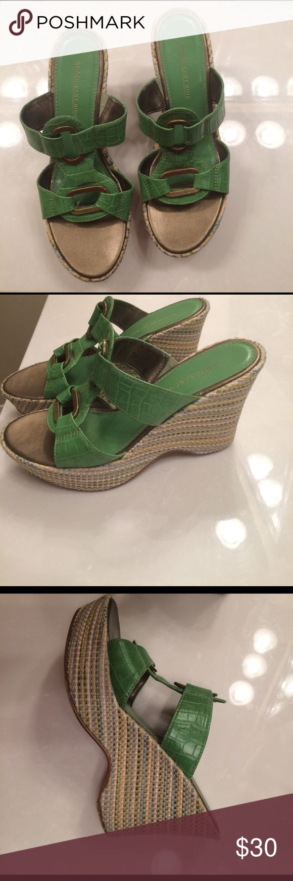Stylish green wedges Green wedges with gold buckles- sides are green/yellow/blue- perfect for St. Patrick's day ☘️💚 these shoes are flawless. Wedges are 4 inches and front is 1.5 inches lower east side Shoes Wedges