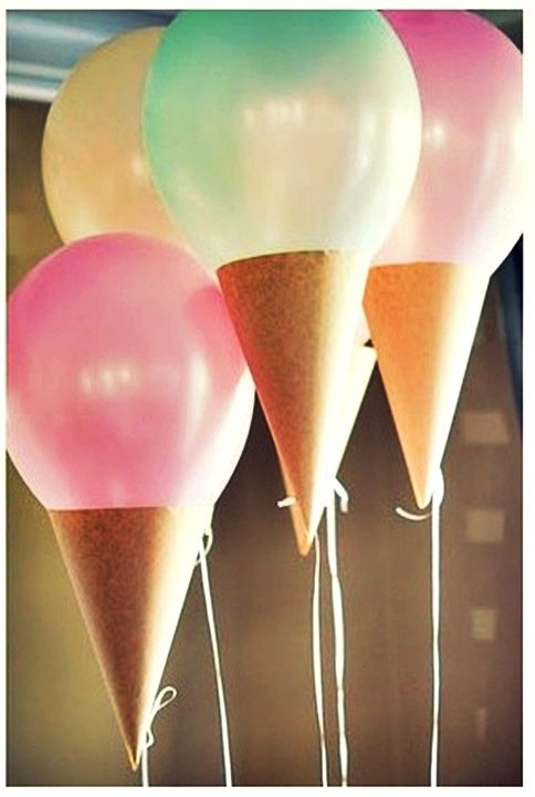 Ice Cream Balloon DIY: Make tan cones from paper with a hole at the bottom, after tying ribbon to the balloons end, string it through the hole at the bottom of the cone and tie another not with enough ribbon tension to hold the cone in place.