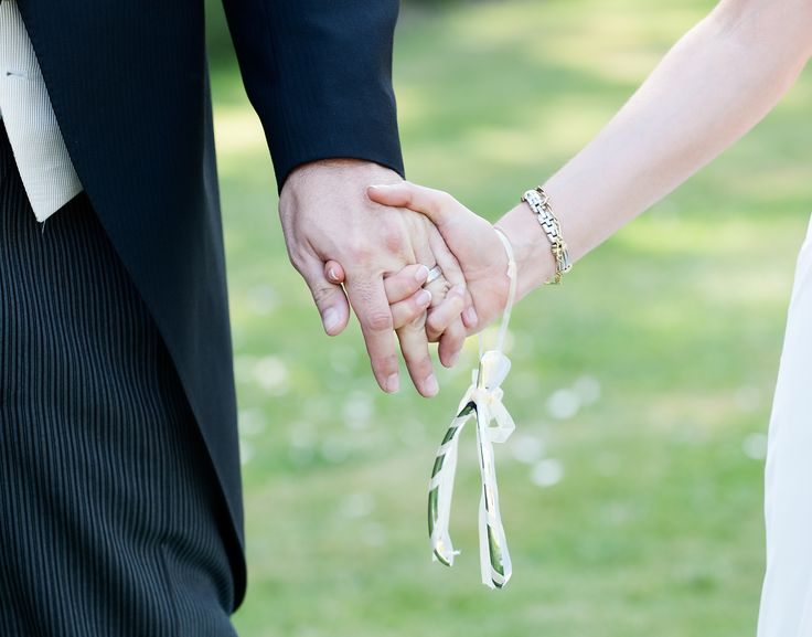 Love is holding hands! Photography by www.newforestweddingphotographers.co.uk
