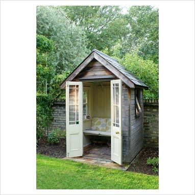 gap photos garden plant picture library small timber summer house with bench seat