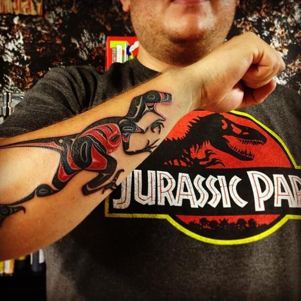 Haida velociraptor tattoo done by Fraktal at Ganesh Studio in Mexico City