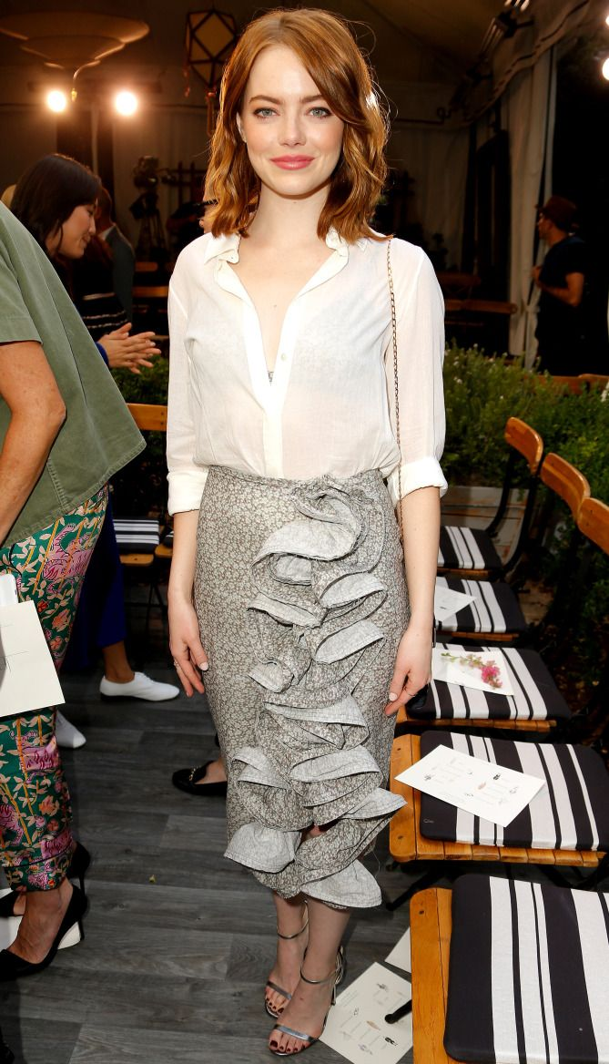 Emma Stone in a white Brock Collection top and gray ruffle skirt