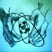 Hands holding atom