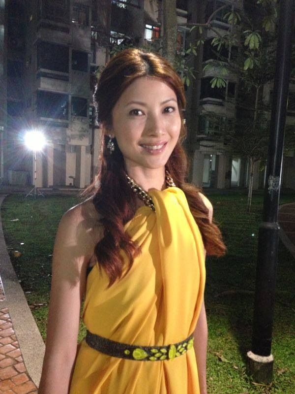 Jeanette Aw in bright yellow.