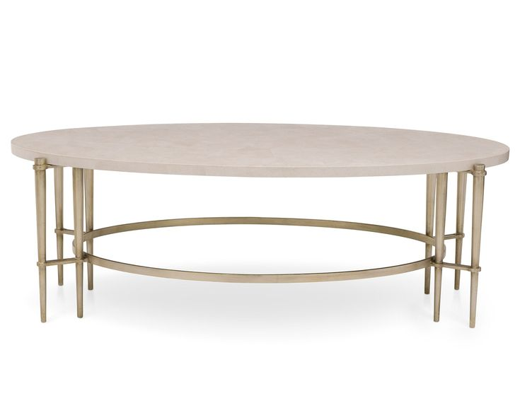 Toulon Oval Coffee Table by Henredon is where white quartz meets silver metal.   #theshowroomatfr #luxurylivingroom