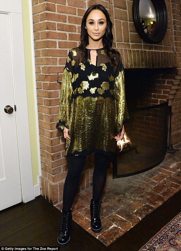 Fashion maven: Cara Santana, 32, wore a crushed velvet dress with a semi-sheer black bodice paired with black tights and black bovver boots