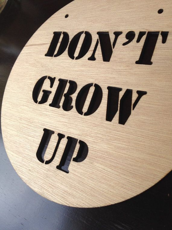 The DON'T GROW UP timber plaque from Katrina Louise Designs is perfect to decorate a baby girls room or nursery.