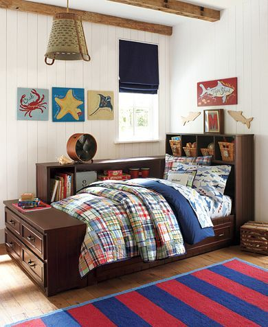 Love the quilted plaid bedding in this boys bedroom photo from Pottery Barn Kids. The striped red and blue rug is a nice nice and adds an extra element of color to the bedroom. For more boys room inspiration visit https://www.facebook.com/BoysRooms you may find something you 'LIKE'