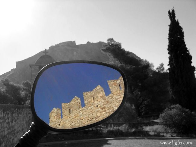 #Palamidi Castle (in B&W in the background) and section of the walls of #Akronafplia Castle (in the mirror). #Nafplio - #Greece
