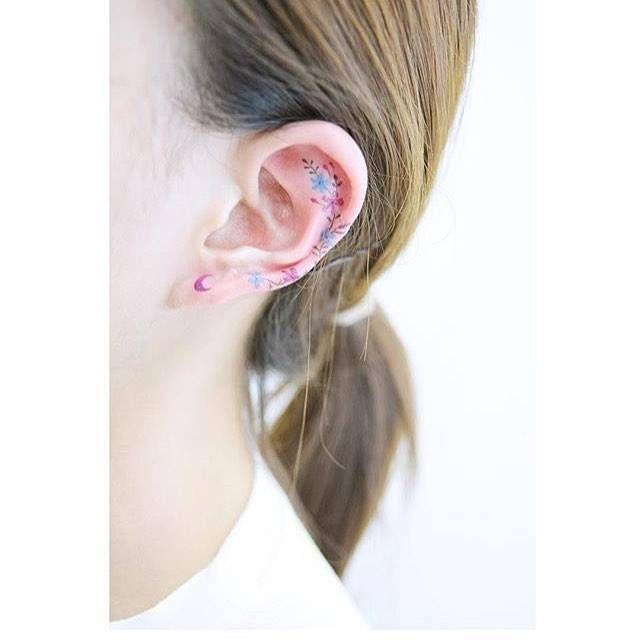 Flower tattoos on the ear.