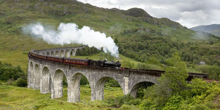 The Jacobite steam train passing over the Glenfinnan Viaduct at the head of Loch Shiel, Lochaber