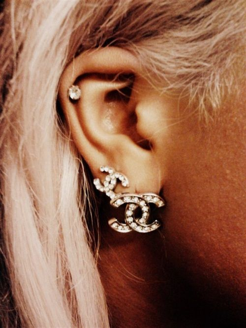 The two Chanel earrings look so chic together. I love the double piercing