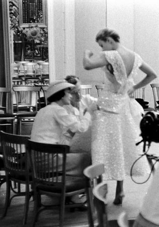 Coco Chanel fitting one of her designs.