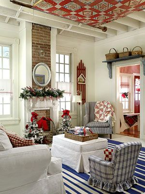 Quilt hung from ceiling for a Red, White, and Blue Cottage Christmas BHG