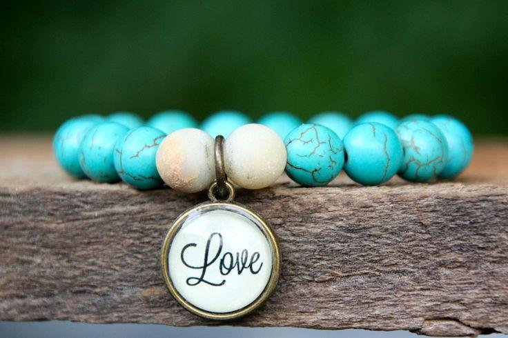 Pretty turquoise Love bracelet.