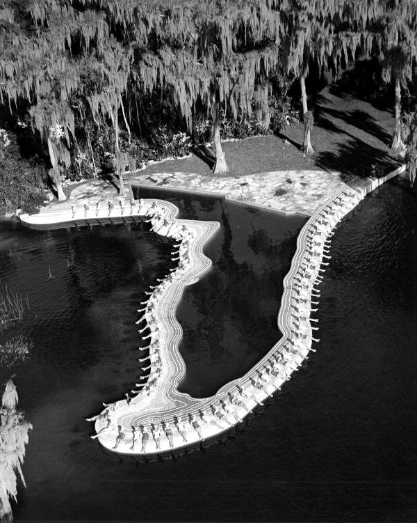 """Florida Memory - Aerial view of swimming pool in the shape of Florida at Cypress Gardens - Winter Haven, Florida. The Esther Williams Swimming Pool at Cypress Gardens, built as a set for """"Easy to Love"""" (1953). State Archives of Florida, Florida Memory"""
