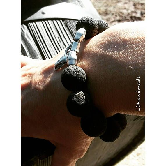 Check out this item in my Etsy shop https://www.etsy.com/listing/587562397/bracelet-lava-12mm-beads-with-silver