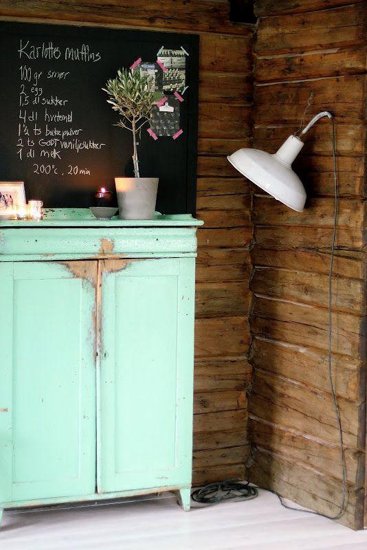 antique dressers in the kitchen for storage! combine a blackboard menu!