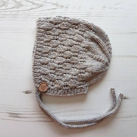 Beautiful little bonnet with a lot of old worldly charm about it. Perfect for boys or girls, this is a great addition to most outfits. Shorts and a t-shirt or summer dress. Winter coats and wellies. #knitting #knits #babyknits #knittingforkids #knittingforbabies #knitsforkids #knitsforbabies #etsy #etsyshop #etsy #babyclothes #babyhat #babybonnet #babyknits #rowrowandkades  https://www.etsy.com/uk/listing/535324759/hand-knit-baby-bonnet-knitted-bonnet