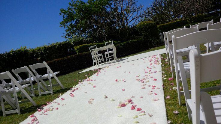 #rosepetals #weddingceremony #whitefoldingchairs #whitecarpet