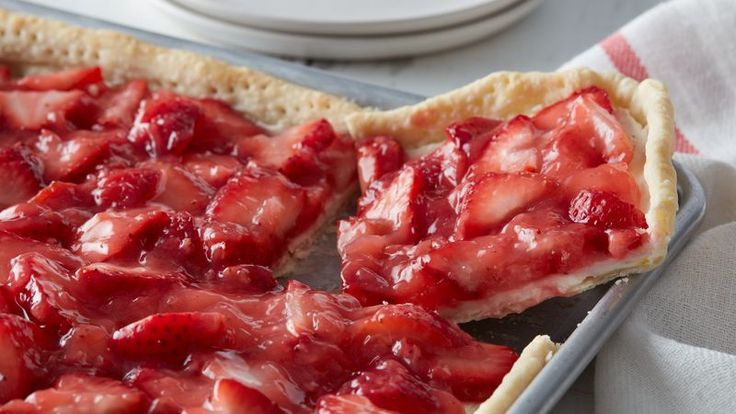 If summer were a dessert, this would be it. Easy to assemble with store-bought crust, layered with lemony cream cheese, and loaded with fresh strawberries, this slab pie is perfect in every way.
