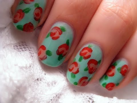 a vintage rose floral nail art design for this spring and summer.    list of products used:  opi's nail envy  eyeko's vintage polish  opi's chapel of love  china glaze's starboard  eyeko's saucy polish  seche vite's dry fast top coat