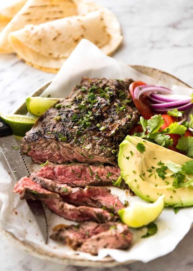 An authentic recipe for Carne Asada, the famous Latin American grilled beef, marinated in a citrusy, garlicky Carne Asada marinade.