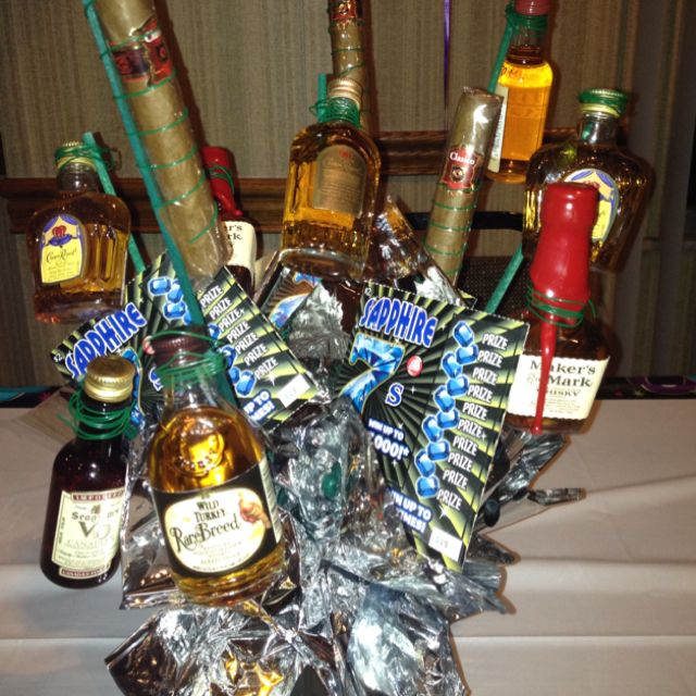 Male gift baskets.....airplane bottles,cigars and lottery tickets!Makes a great centerpiece too!
