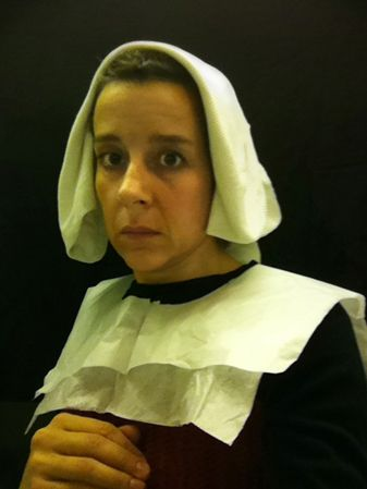 To pass the time during long flights, artist Nina Katchadourian goes to the lavatory, adorns herself in tissue paper costume - Flemish style.