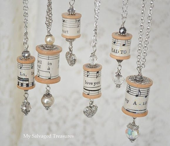 Necklaces made from vintage wooden spools and sheet music