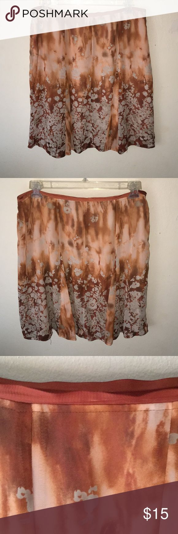 Flirty Skirt This is a beautiful skirt fun and flirty and very flowy . Can be paired with a tank top and cardigan or worn with a bodysuit. It has a side zipper as well . Great condition . Colors of this skirt are: tan, cream, brown, burnt orange. Please note, as shown in the picture the clasps on the side of the skirt will need to be reinforced its slightly loose. L: 24 1/2 inches Worthington Skirts Mini
