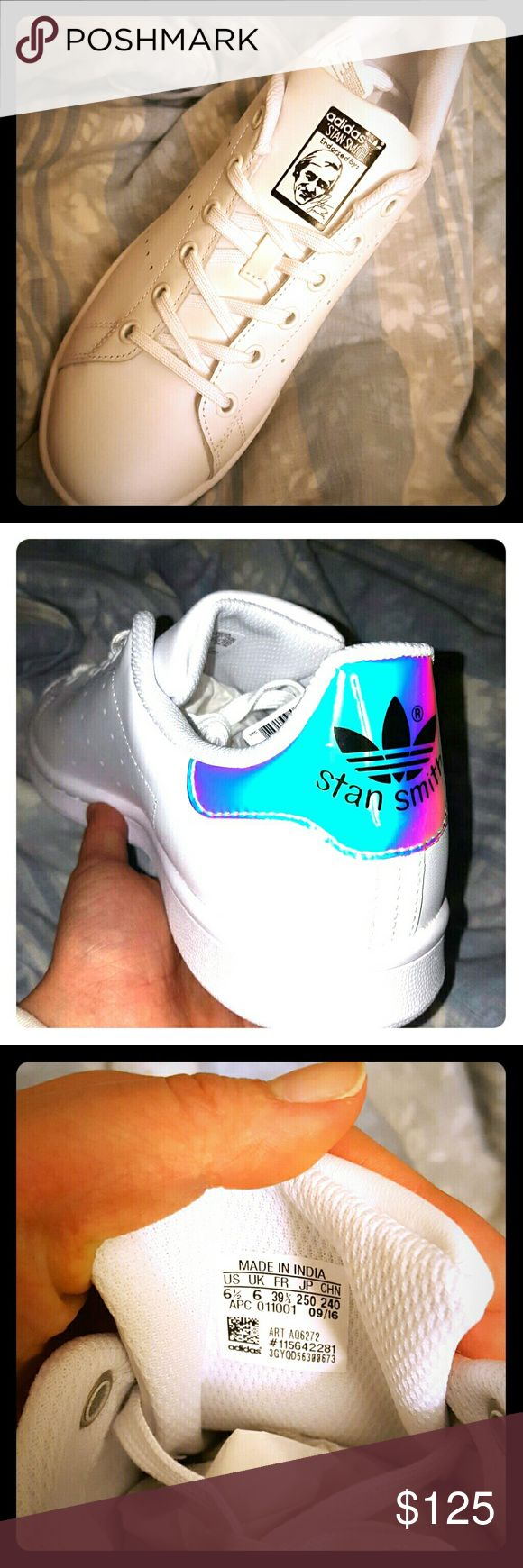 Adidas Holographic Stan Smith Brand new in box! Super shiney, love love love! I would say these run a little big but not enough to size yourself up or down unless your foot requires a wide or slim fit. I did get them in the youth section, however, the tongue label reads as a (mens 6.5)/(womens 7.5) and the label matches up with the size chart on the adult adidas website. Let me know if you need more pictures :) Adidas Shoes Sneakers
