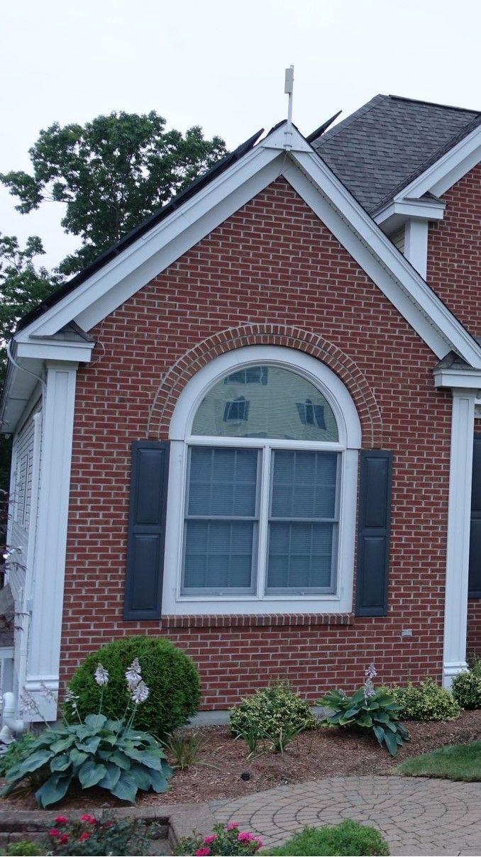 Beautiful use of exterior vinyl shutters to showcase a home window.   #shutters #exteriorshutters #homeimprovements #DIY #vinyl