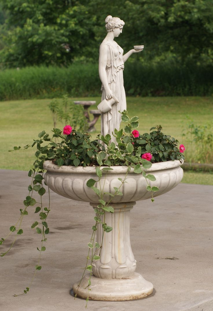 Pretty garden #fountain turned into a planter / #ContainerGardening
