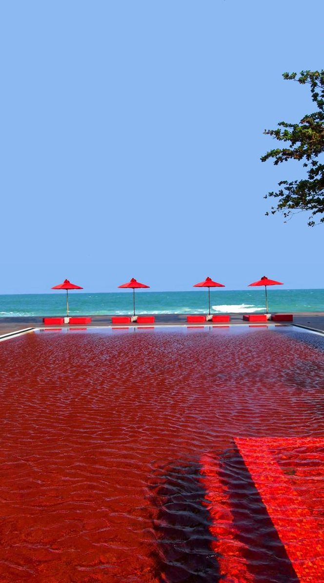 Red swimming pool at The Library in Koh Samui, Thailand