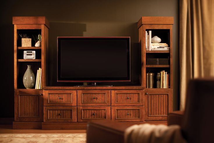 """An attractive surround for this flat screen TV is created with a console and two tall Entertainment cabinets.  This Designer Cabinetry is shown with """"Vintage Beaded Panel"""" door style in Cherry, with Heavy Heirloom """"K"""" finish."""