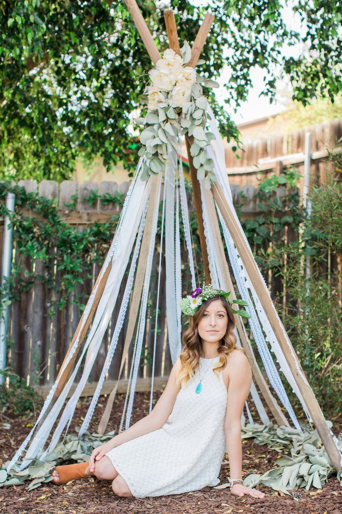 lace and ribbon teepee for a backyard bohemian bridal shower
