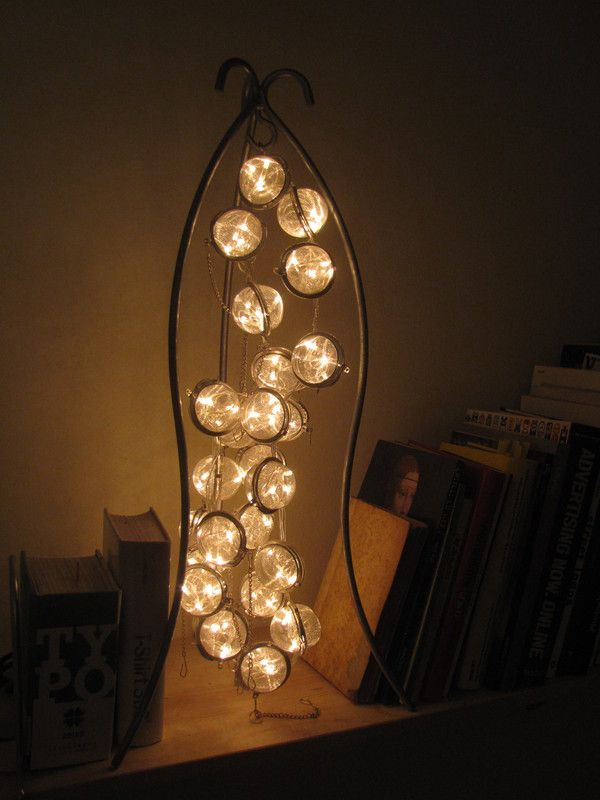 DIY Inspo: lamp made from tea strainers.
