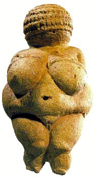 The Venus of Willendorf, also known as the Woman of Willendorf; 11 cm (4.3 in) high statuette of female figure estimated to have been created between 24,000 and 22,000 BCE. Discovered in 1908 by archaeologist Josef Szombathy at a paleolithic site near Willendorf, a village in Lower Austria. Oolitic limestone that is not local to the area, and tinted with red ochre.