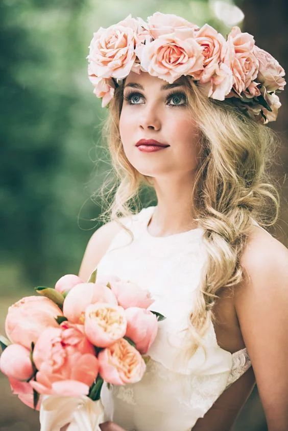 Pink rose flower crown for a wedding with a side braid