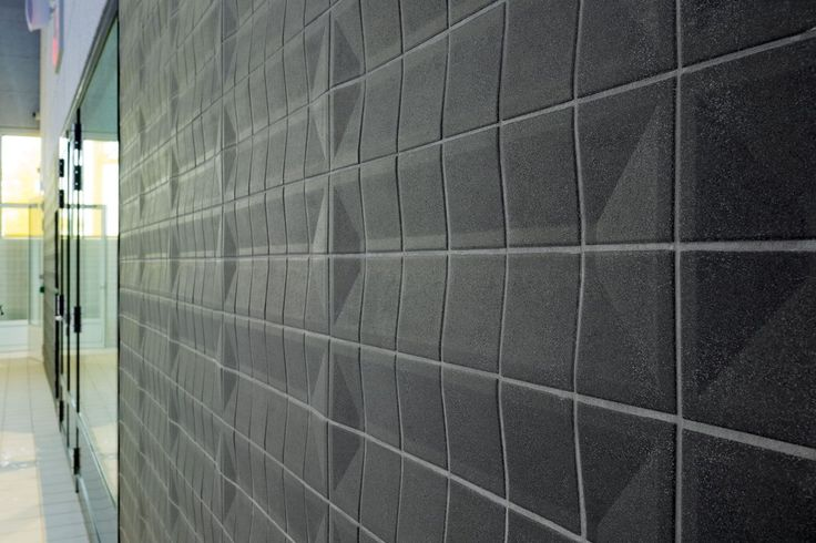 Acoustic wall at Sportcomplex Koning Willem-Alexander by Slangen+Koenis - done with tiles by Agrob Buchtal