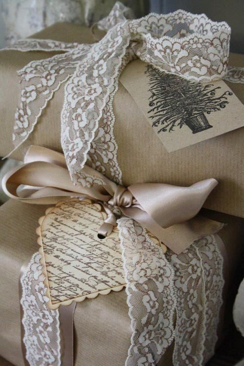 Brown paper, satin ribbon, lace trim, and vintage tags makes for some pretty gift wrappings.