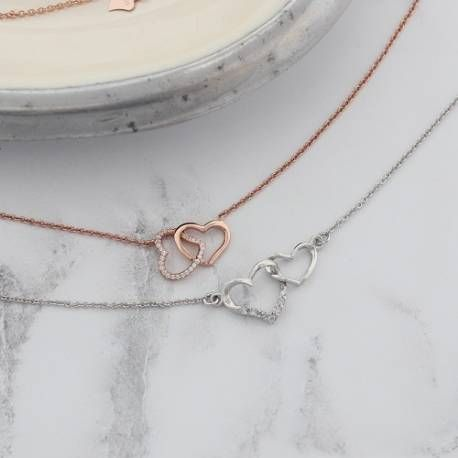 entwinned heart necklace in rose gold or silver with pave crystals #valentinesday #valentinegifts #valentinesjewellery #heartnecklace #giftsforher